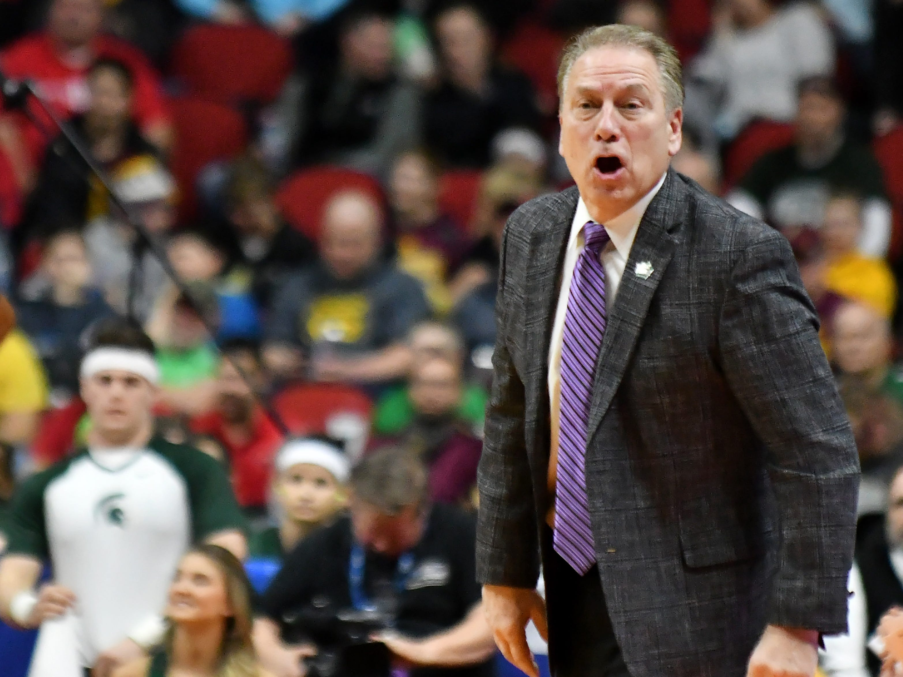 Michigan State head coach Tom Izzo yells instructions to his players in the first half.
