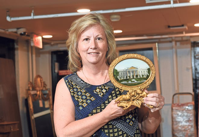 Paula Morris with her White House mantle piece at the DuMochelles Art Galleries.
