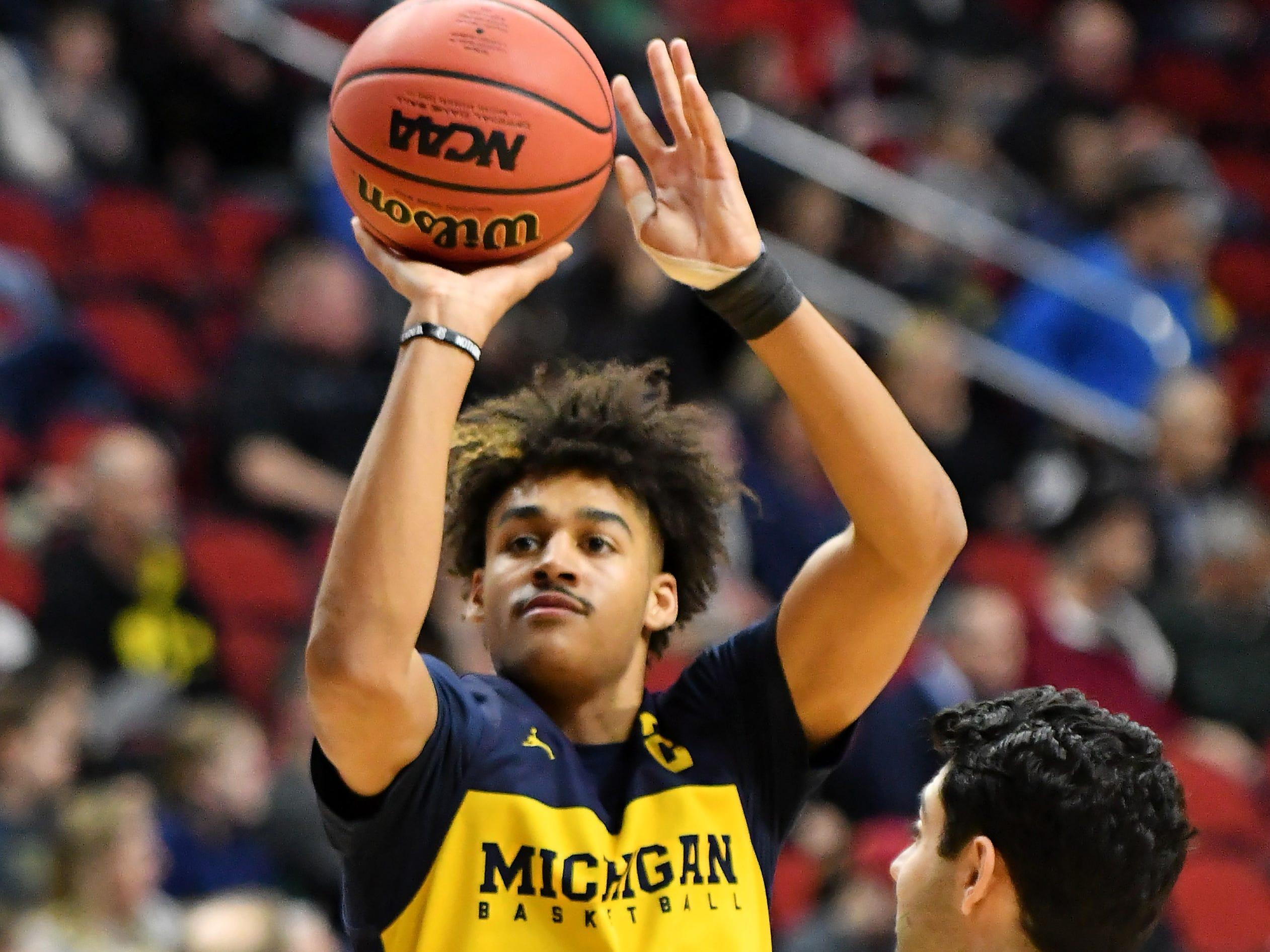 Michigan guard Jordan Poole takes a shot at practice.