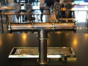 A tabletop tap system at the Brakeman, a beer hall opening Monday in downtown Detroit.