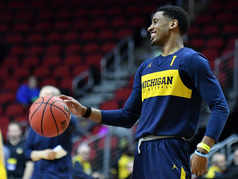 Michigan guard Charles Matthews smiles during  Michigan practice.