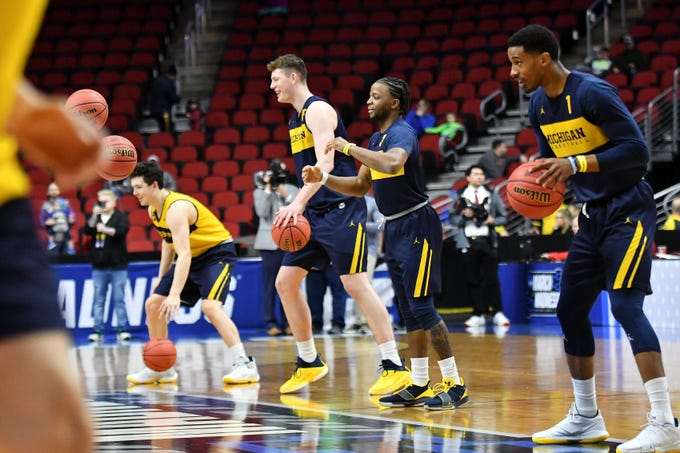 From right, Michigan guard Charles Matthews (1), Michigan guard Zavier Simpson (3), Michigan center Jon Teske (15) and Michigan forward C.J. Baird do a warmup drill at practice before its NCAA Tournament opener on Wednesday, March 20, 2019, at Wells Fargo Arena in Des Moines.
