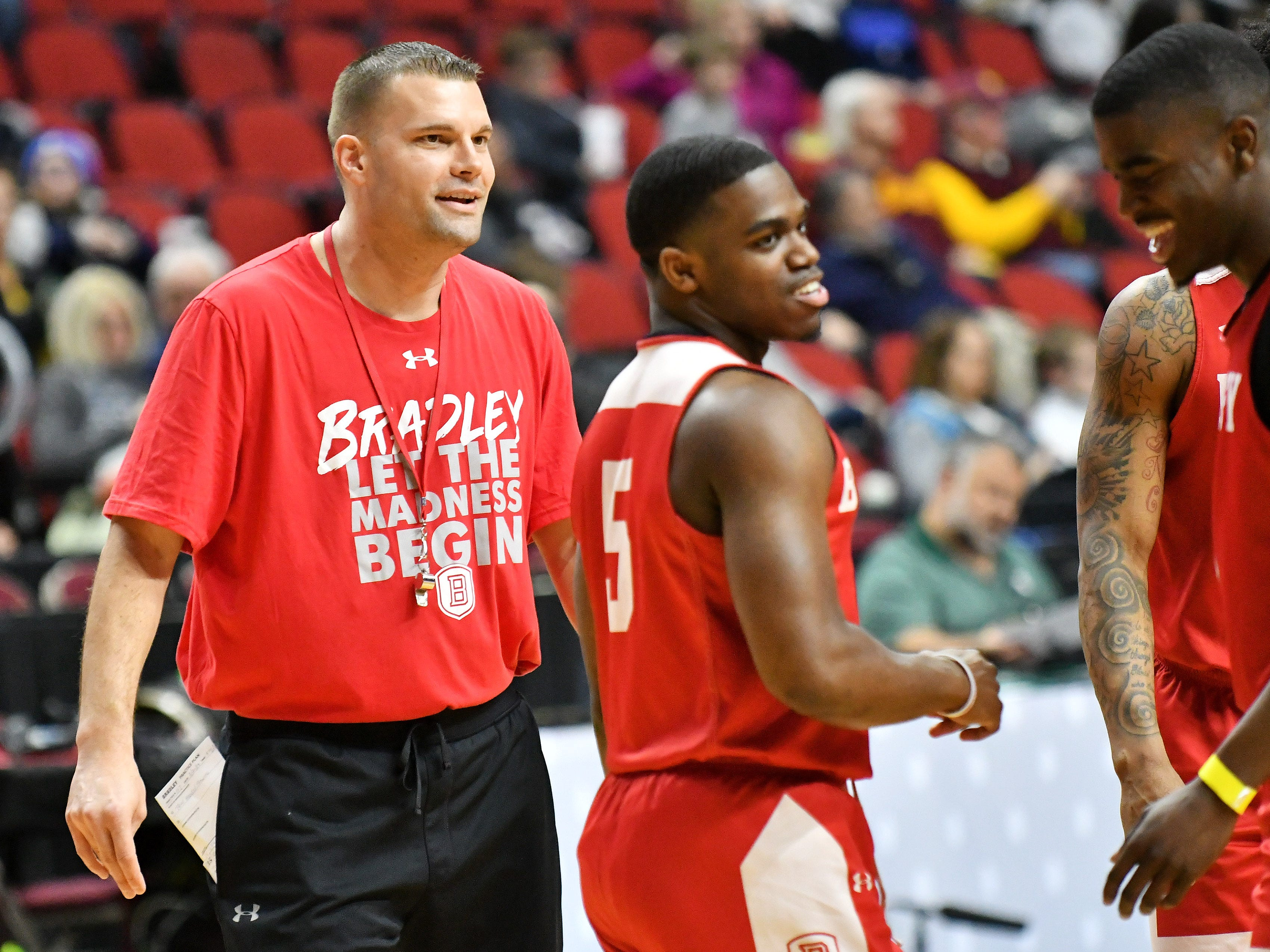 Bradley head coach Brian Wardle, left, and guard Darrell Brown at practice.