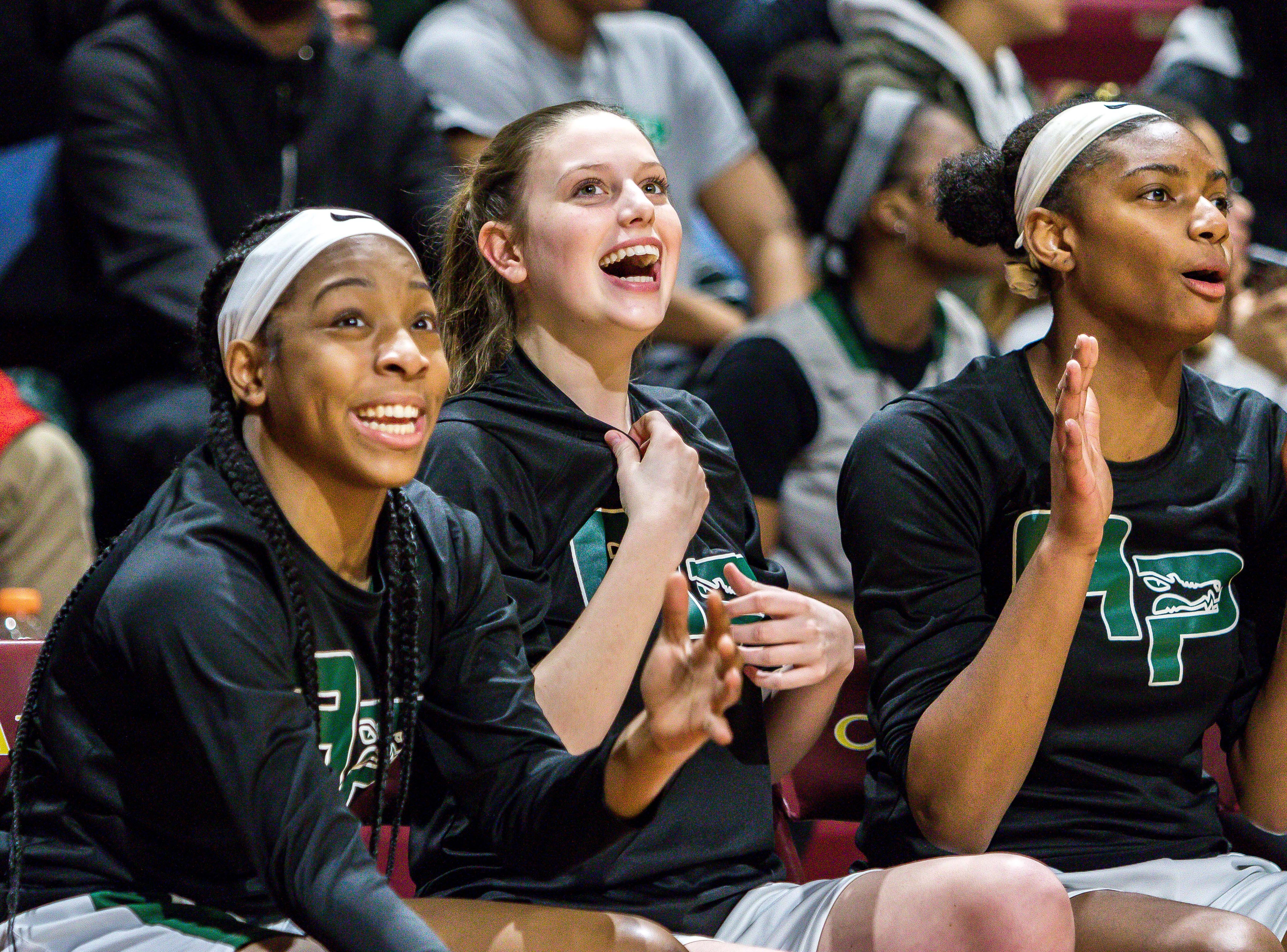 Ypsilanti Arbor Prep's bench reacts as they tie the game late in the second half.