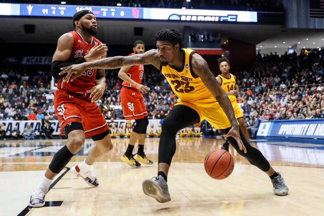 Arizona State's Romello White drives against St. John's Marvin Clark II, a former Michigan State player, during the First Four game in Dayton on Wednesday.