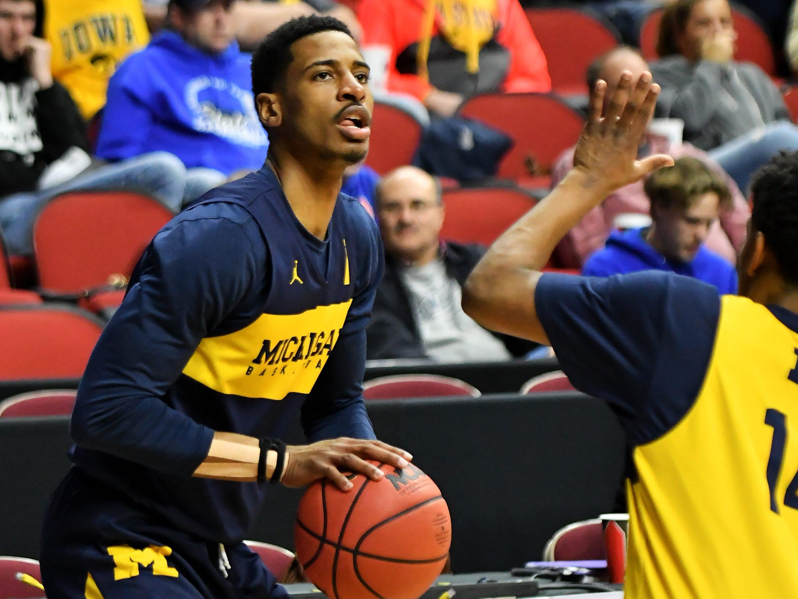Michigan guard Charles Matthews shoots around at practice.