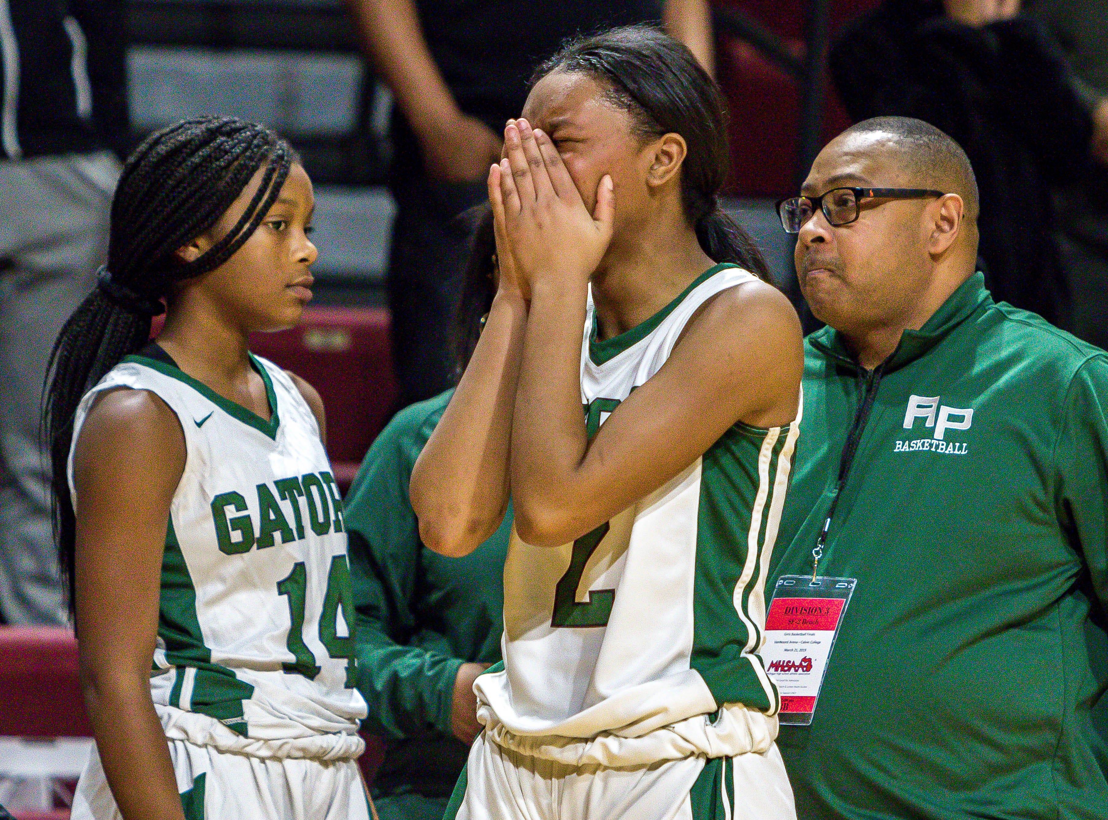 Ypsilanti Arbor Prep's Jazmin Chupp (2) reacts after a heartbreaking overtime loss.