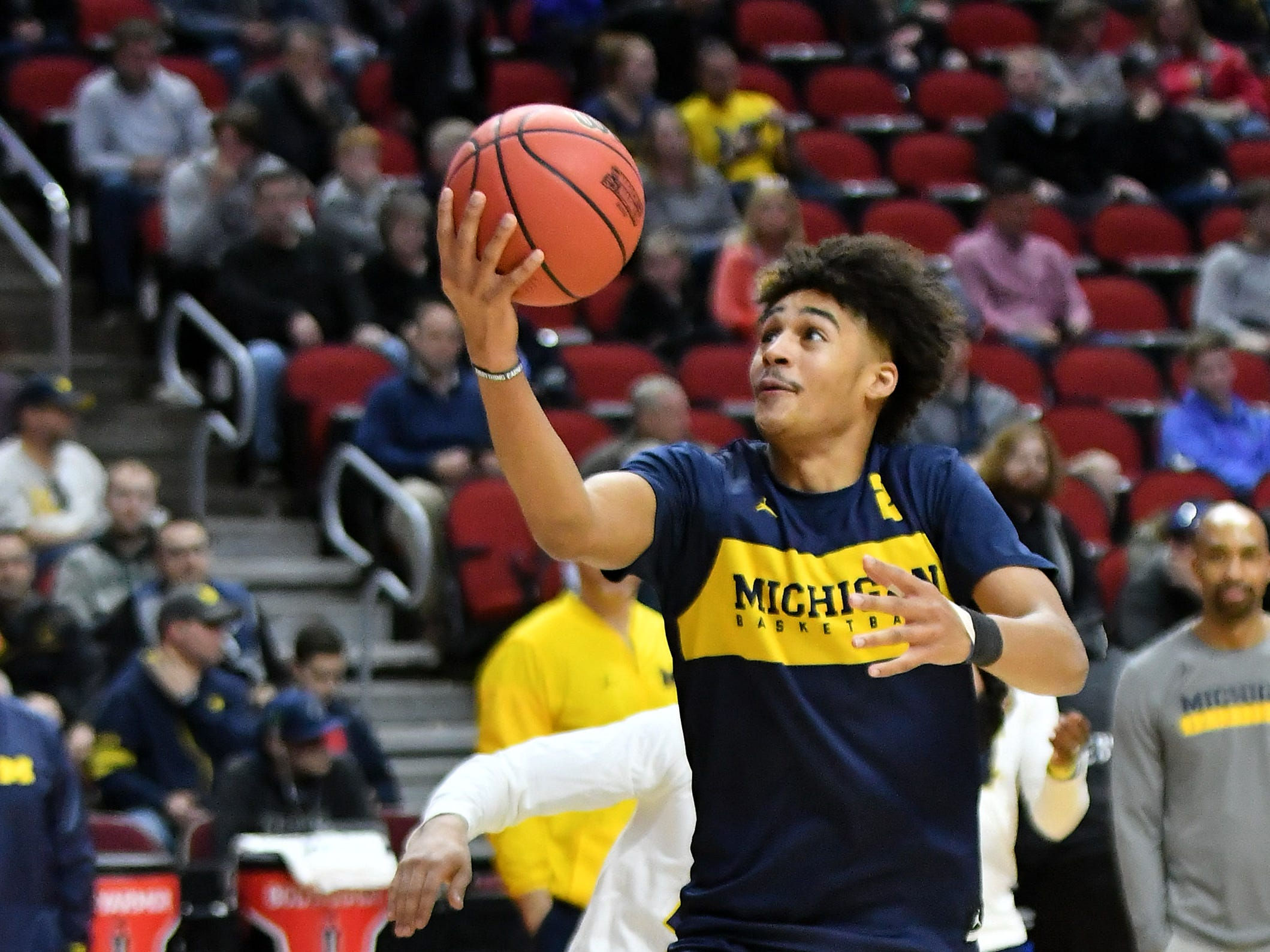 Michigan guard Jordan Poole goes to the basket at practice.