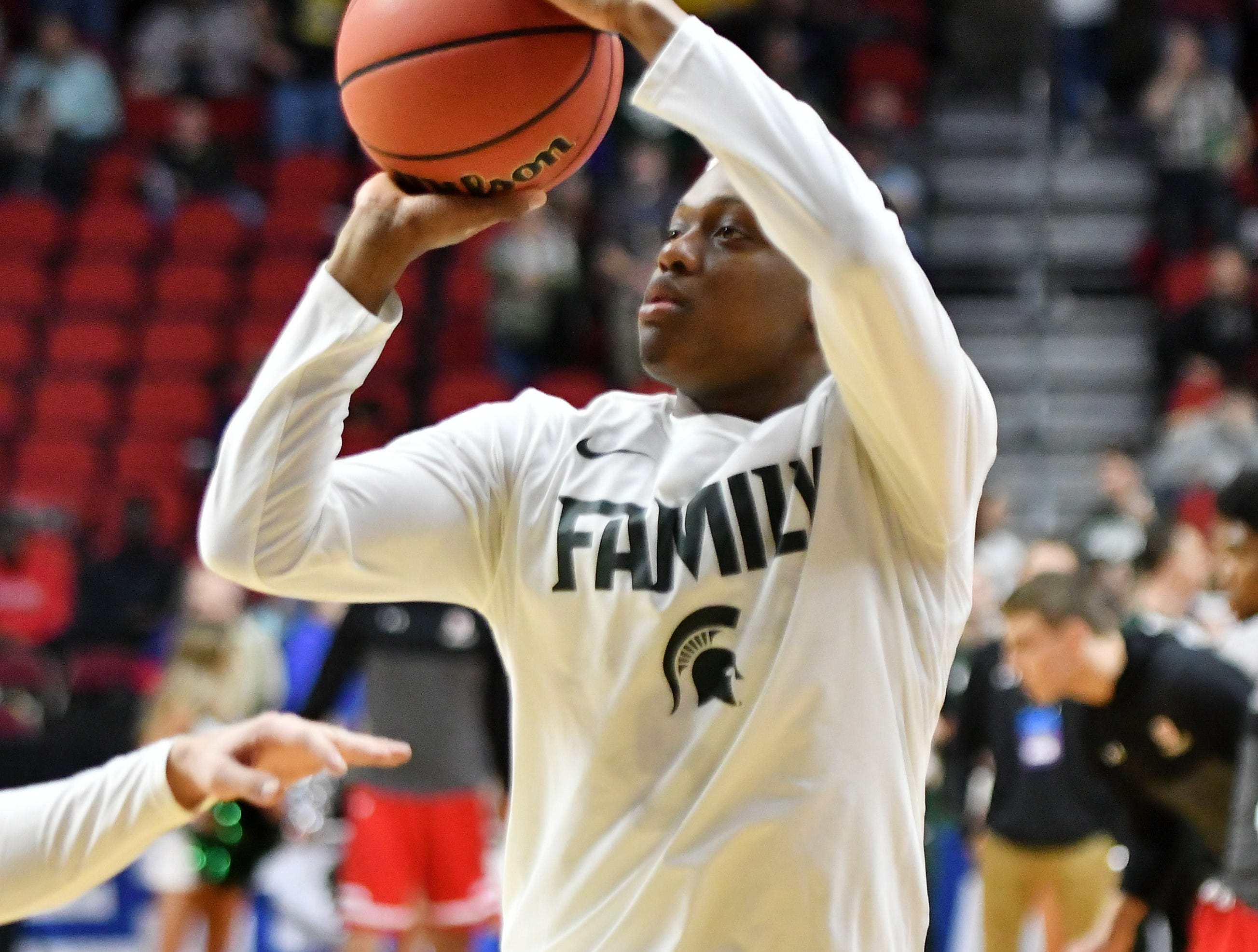 Michigan State guard Cassius Winston shoots around before the game.
