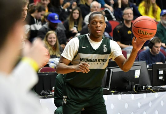 Michigan State guard Cassius Winston passes to a teammate during Wednesday's practice in Des Moines, Iowa.