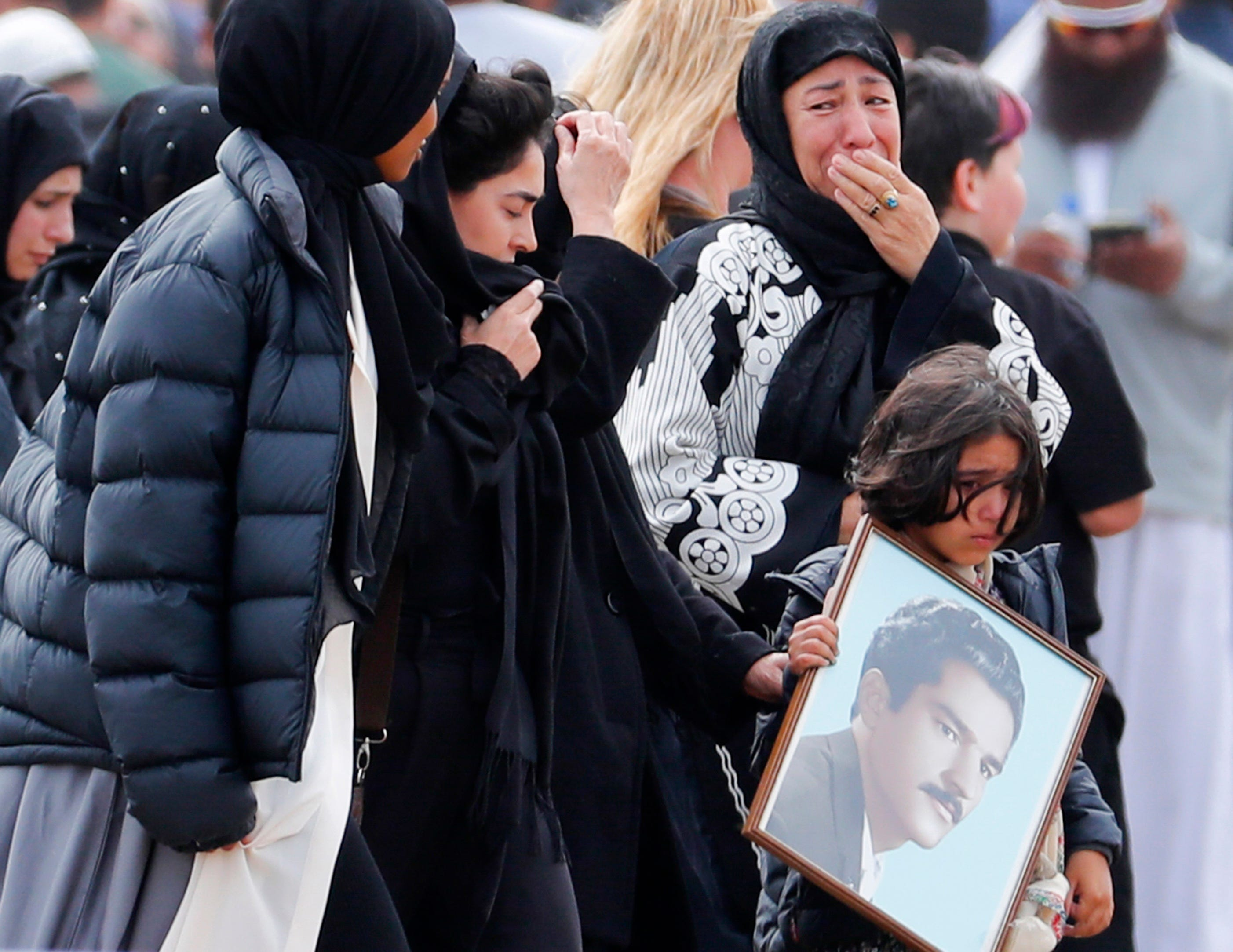 Mourners arrive for a burial service of a victim from the March 15 mosque shootings at the Memorial Park Cemetery in Christchurch, New Zealand, Thursday, March 21, 2019.