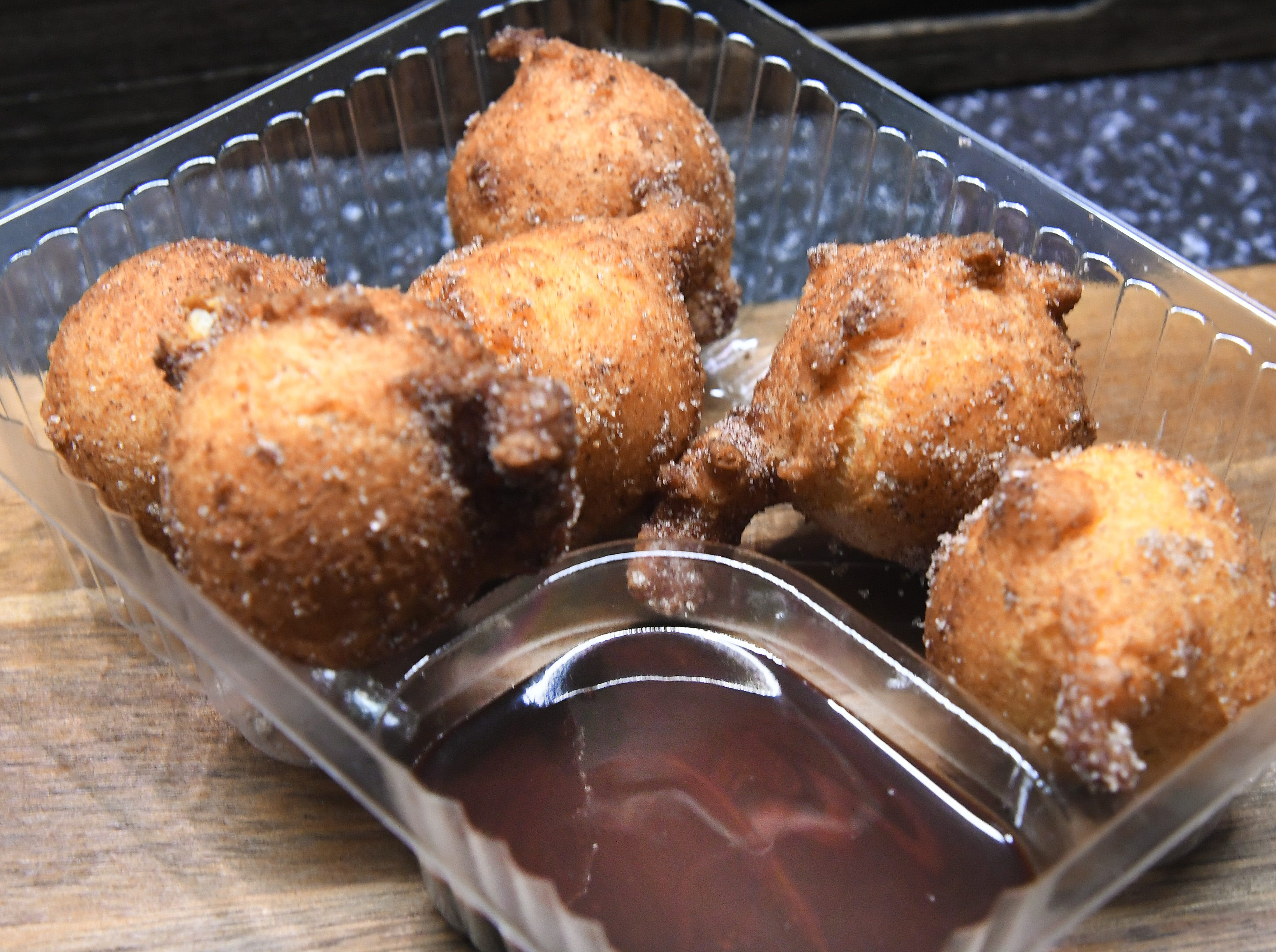 """""""Zeppole,"""" a sweet deep-fried Italian pastry dough balls served with chocolate dipping sauce."""