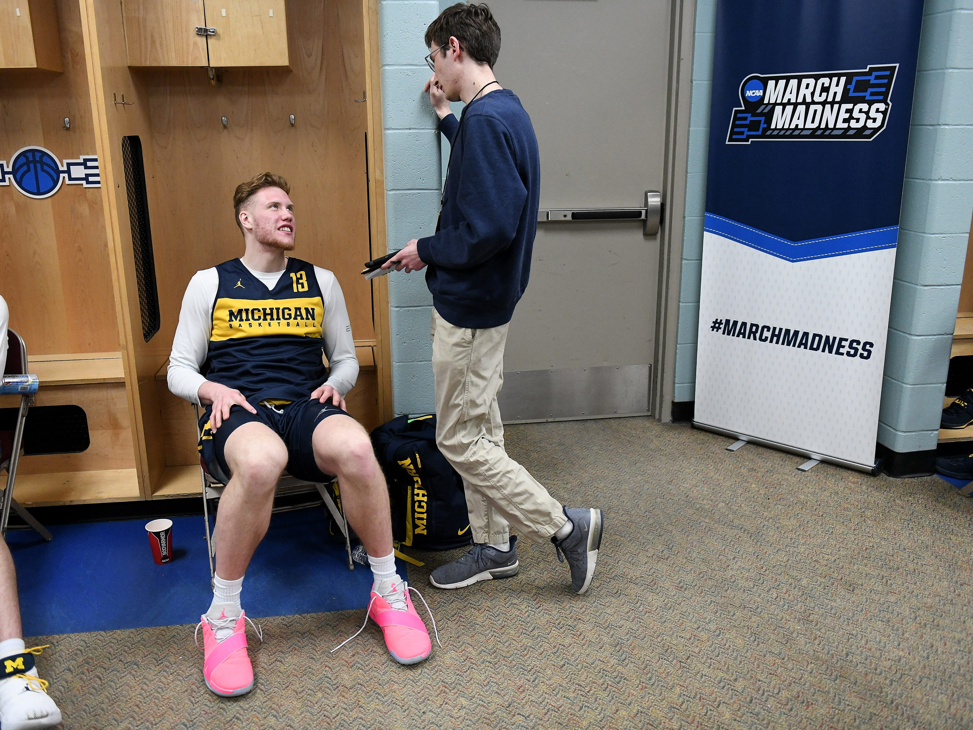 Michigan forward Ignas Brazdeikis talks with a member of the media.