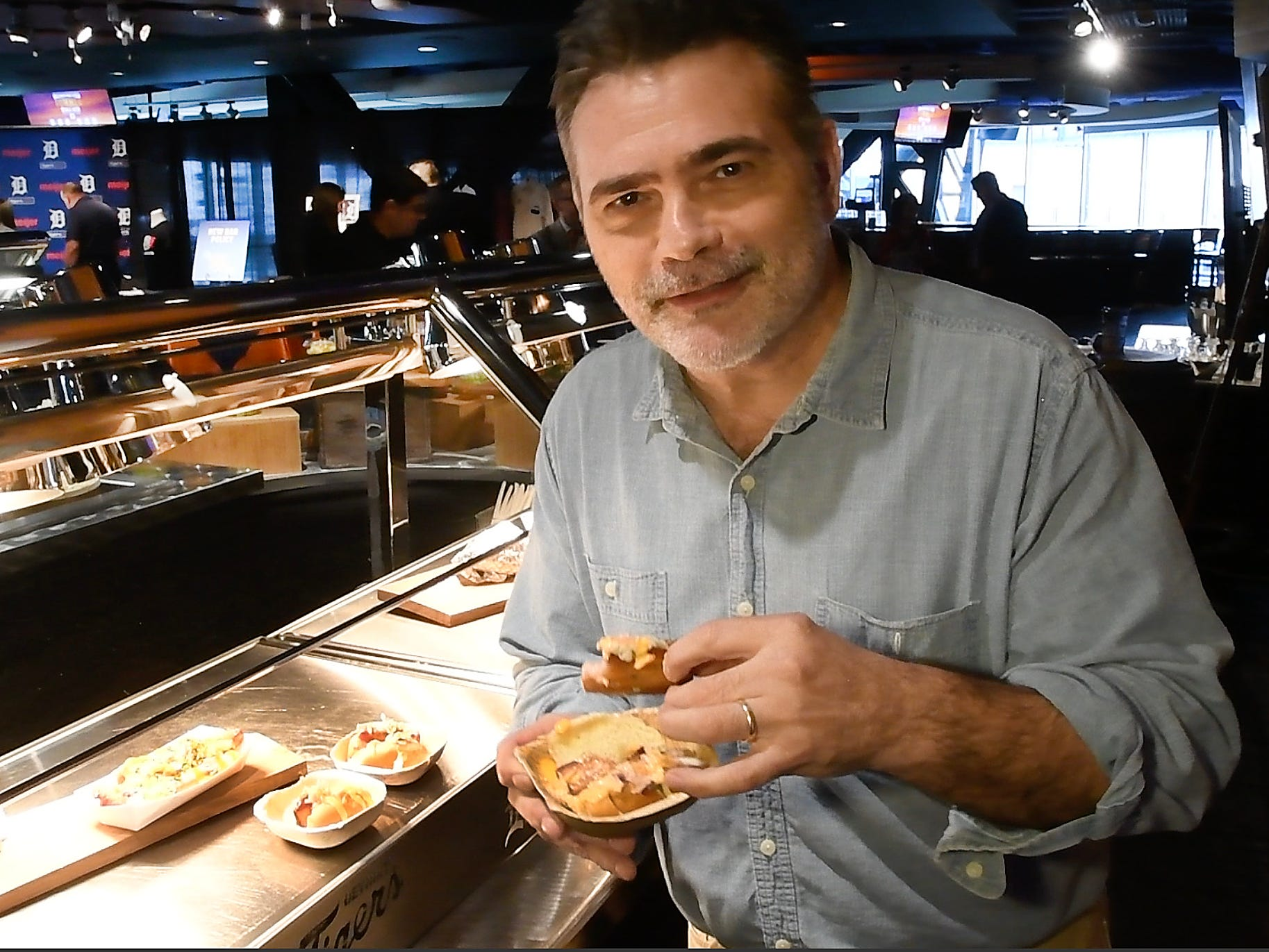 """Detroit News reporter George Hunter tries out the Coney Dog Eggroll and likes it, he really likes it during the """"What's new at Comerica Park in 2019"""" food sampling event."""