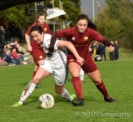 Madison Schupbach battles a Swansea City FC player for the ball.