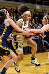 Mya Petticord (1) draws a foul as she's tangled up between a pair of  Pewamo-Westphalia players in a Class C state semifinal Thursday at Calvin College.
