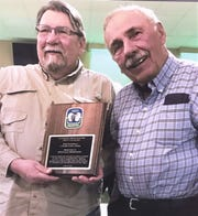 Jack Sincock, right, a member of the Catharine Creek Chapter of Trout Unlimited, presents the chapter's John Woodhull Conservation Award to Doug Thornton of Spencer.