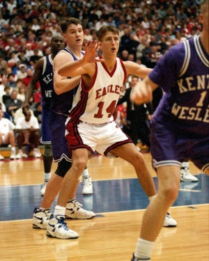 Chad Gilbert posts up a defender during the 1995 season as he helped spark USI to the NCAA Division II championship.