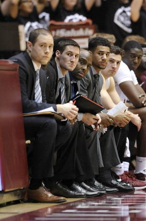 Bryan Mullins, second from left, is the new head basketball coach at Southern Illinois.