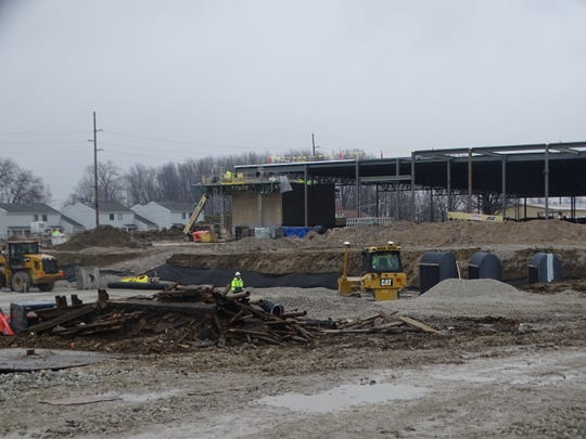 Contractors worked in the rain Thursday at the new Kroger site on Cedar Street. The new store should be open before the end of 2019, according to city and Kroger officials.