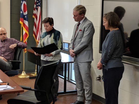 The Port Clinton Board of Education recognized Jeff Dornbusch, center, for being named Treasurer of the Year.  Presenting him with a commendation at the March 18 meeting is Board President Beth Benko and Michele Mueller, vice president.