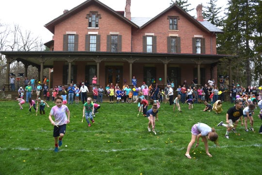 Kids can play traditional egg games on the lawn of the Hayes Home in Fremont during the annual egg roll.