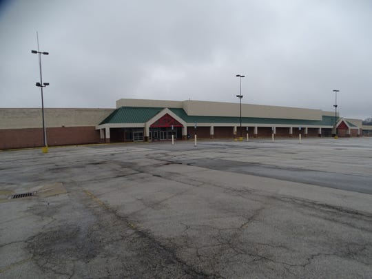 The former K-Mart building, located along Oak Harbor Road in Fremont, is one of several vacant building sites in the city.