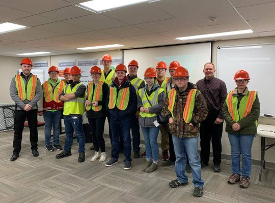 Students from local schools tour manufacturing companies.