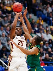 Florida State redshirt sophomore forward Mfiondu Kabengele attempts a basket over Vermont guard Stef Smith during the first half of a game in the first round of the 2019 NCAA Tournament at XL Center.