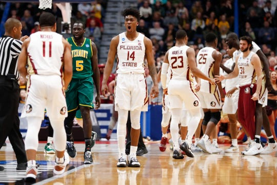 Florida State senior guard Terance Mann (14) reacts during a timeout in the second half against Vermont in the first round of the 2019 NCAA Tournament at XL Center.