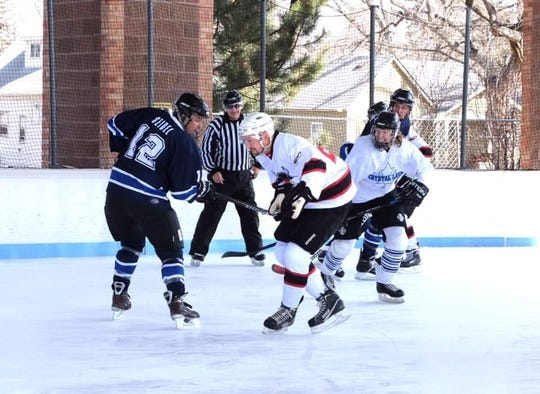 Fort Collins Police Services ice hockey team, the Blue Warriors, played against Poudre Fire Authority's team in an outdoor game in Longmont in February 2019.
