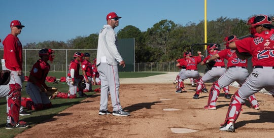 Boston Red Sox catching coordinator Chad Epperson works with minor league catchers at the practice fields behind JetBlue Park on Thursday. Epperson is a Bishop Verot graduate.