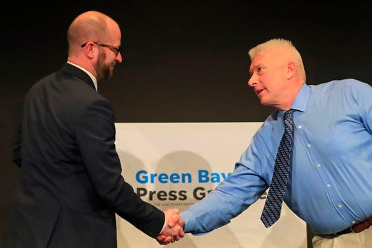 Candidates for mayor of Green Bay, Eric Genrich (left) and Patrick Buckley, shake hands after a mayoral debate hosted by the Green Bay Press-Gazette at the Brown County Library auditorium on Wednesday, March 20, 2019 in Green Bay, Wis.