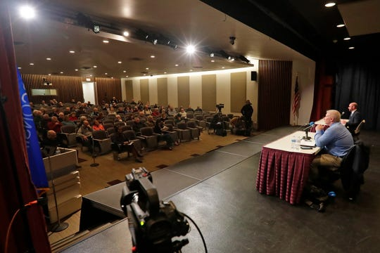 Patrick Buckley and Eric Genrich, candidates for mayor of Green Bay, participated in a mayoral debate hosted by the Green Bay Press-Gazette at the Brown County Central Library auditorium on Wednesday.