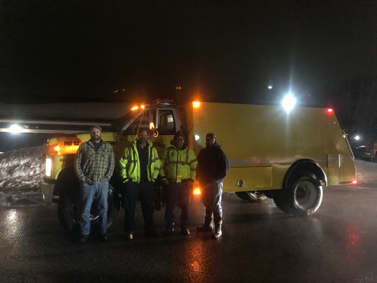 A crew from the Washington Island Fire Department assembles in Bayfield on the mainland to transport their truck across the ice road to Madeline Island. Pictured are, from left:  Troy Nelson, ice road operator; Hoyt Purinton, assistant chief, Washington Island Fire Department; Captain Tom Bloch of the Washington Island Fire Department; and Alan Hardie, assistant chief of the LaPointe Fire Department.