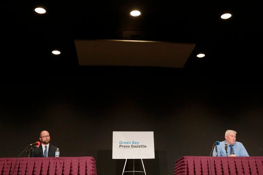Candidates for mayor of Green Bay, Eric Genrich (left) and Patrick Buckley, participate in a mayoral debate hosted by the Green Bay Press-Gazette at the Brown County Central Library auditorium on Wednesday.