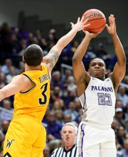 Furman guard Jordan Lyons (23) says the greater distance for the 3-point goal this season doesn't deter him.