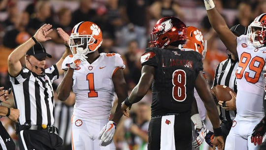 Clemson's Trayvon Mullen (1)  and his cousin, Louisville's Lamar Jackson (8) during the teams' ACC game at Louisville in 2017.