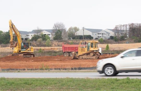 Construction alongside State 153 Thursday, Mar. 21, 2019.
