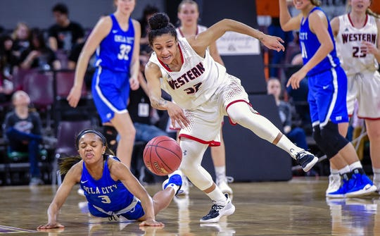 Montana Western's Brianna King (32) steals the ball from Oklahoma City's Shamika Smith (3) as Montana Western takes on Oklahoma City in the championship game for the 2019 NAIA National Championship at Rimrock Auto Arena at MetraPark in Billings, Mont. on Tuesday, March 19, 2019.