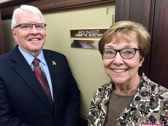 Sen. Mike Lang and Senate Secretary Marilyn Miller stand by Jack Racicot's nameplate on the wall  outside his cubicle at the Capitol.
