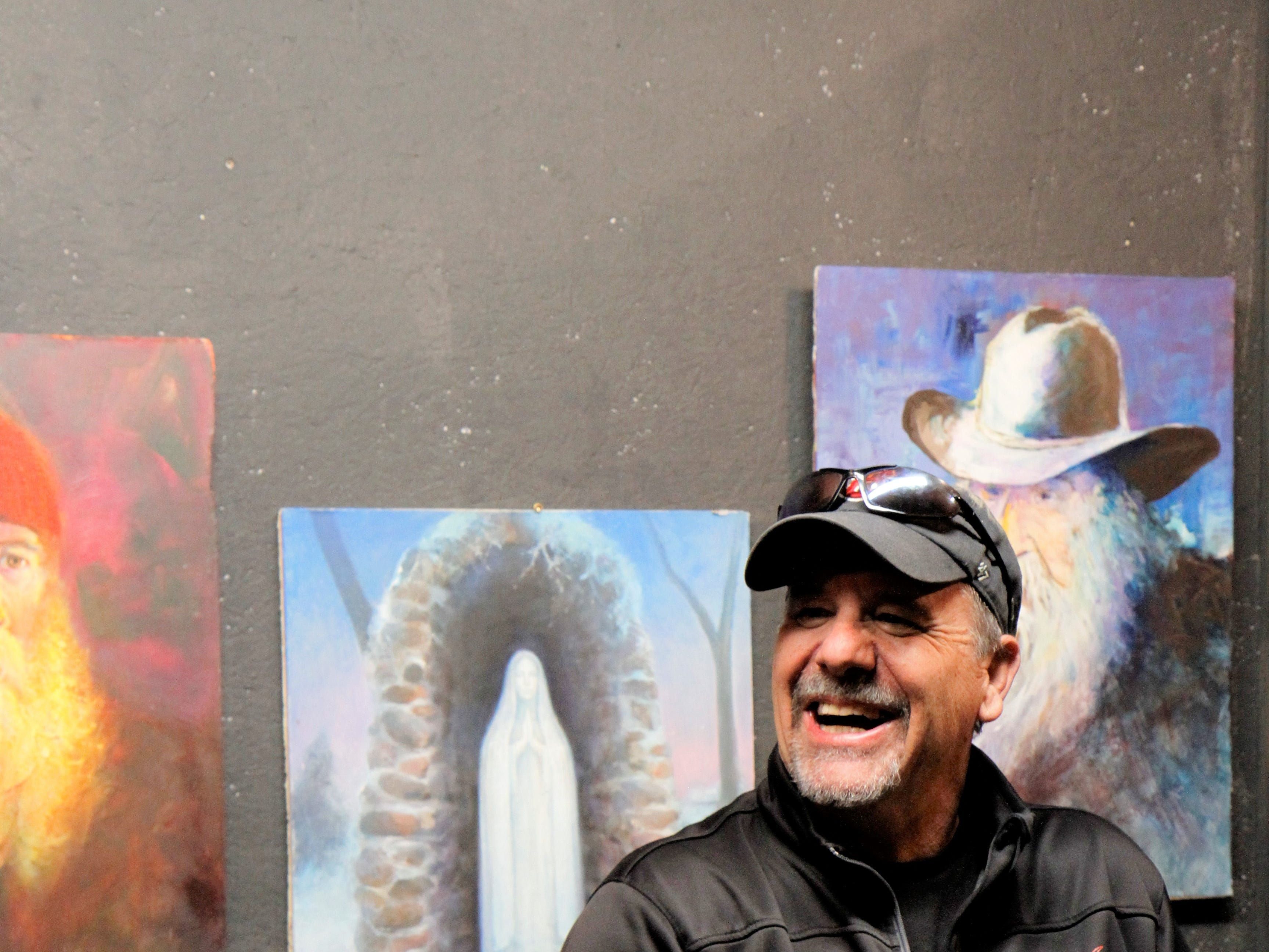Brian Morger laughing with Roland Taylor as he set up his art station on the show's opening night.