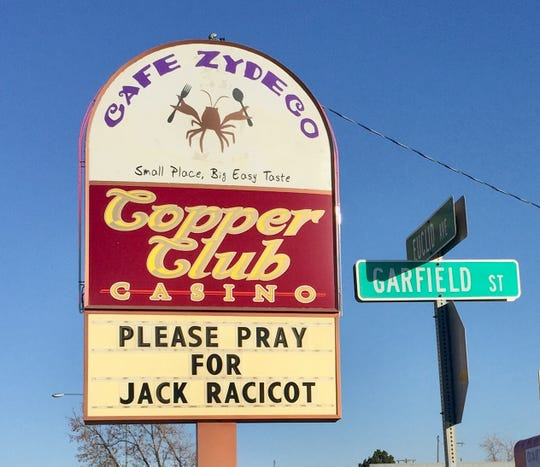 A sign on Euclid Avenue in Helena asks people to keep Jack Racicot in their thoughts.,