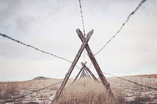 Cascade photographer Sage DuBois was hunting with her husband when she noticed this unusual perspective on a barbed-wire jack fence. She's part of the Jay Contway and Friends Show at the Hilton Garden Inn.