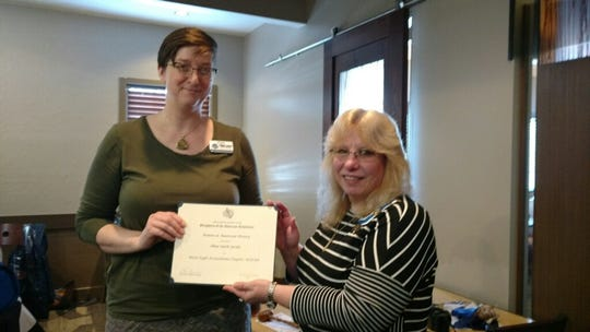 Katie Richmond presented with the Chapter American Women in History Award for Alma Smith Jacobs.