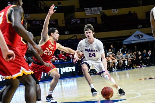 Carroll College senior Matt Wyman, a former Great Falls High star, handles the basketball against St. Thomas of Texas Thursday during NAIA national tournament play in Kansas City.