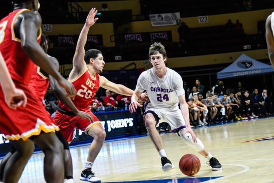 Carroll College senior guard Matt Wyman handles the basketball during NAIA National Tournament play last week in Kansas City.