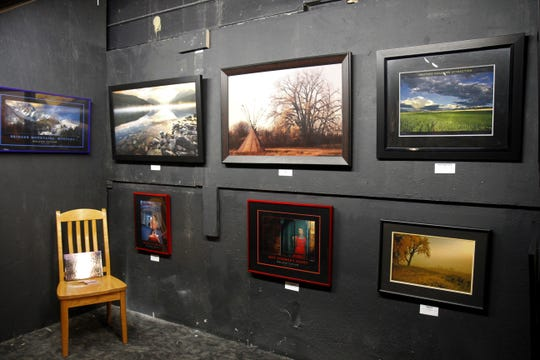 Roland Taylor's section at the art show featuring his photo of Bowmen Lake on at the top right.