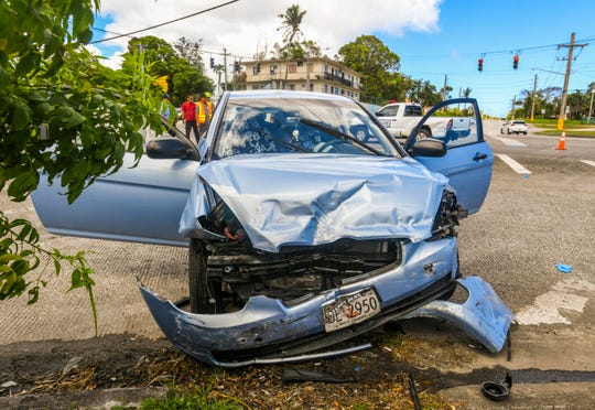 Guam Police Department officers investigate a three vehicle collision at the intersection of Route 10 and Route 15, near the Capt. Price Elementary School in Mangilao on Thursday, March 21, 2019.