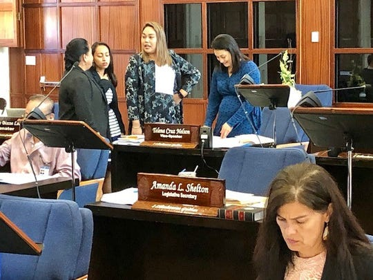 Speaker Tina Muna Barnes confers with Sen. Regine Biscoe Lee, Sen. Amanda Shelton and Vice Speaker Telena Nelson, while Sen. Telena Nelson, foreground, reviews documents, during a short session break on March 21, 2019.